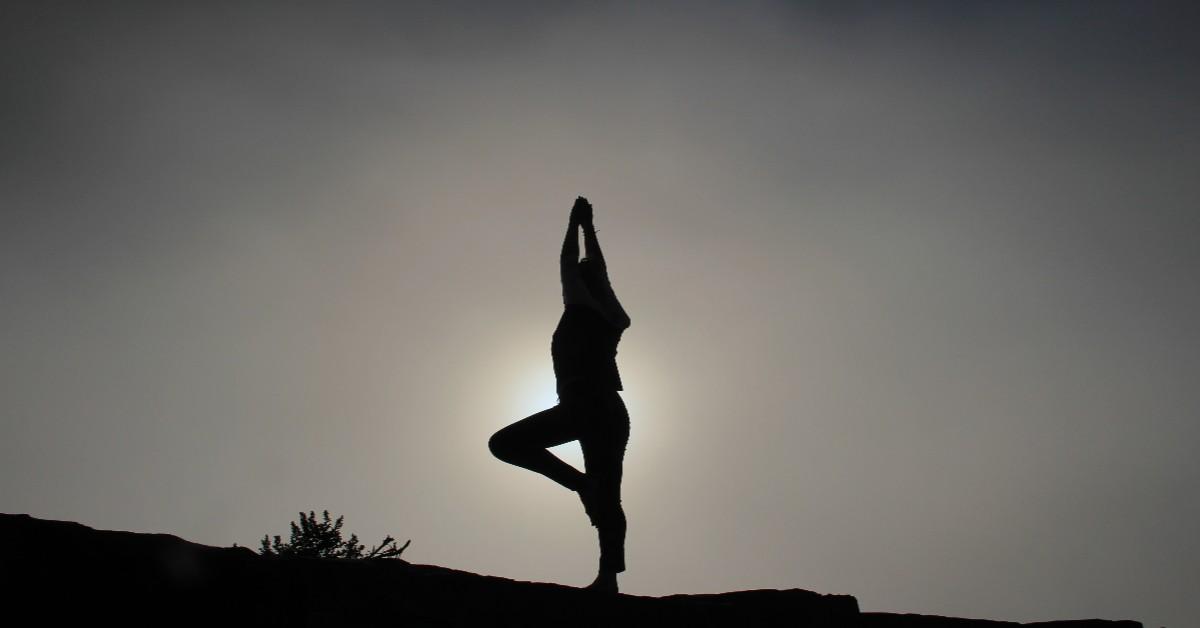 yogini silhouette blocking sun, black and white